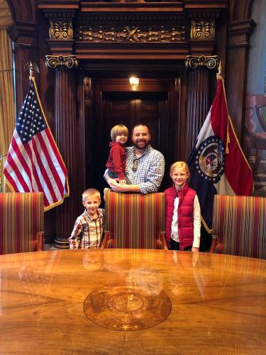 Michael and his three kids in the Missouri Governor's office.