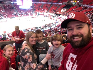 Michael and his family at a University of Oklahoma Sooners basketball game in January 2019.